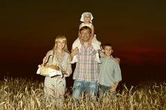 Happy family on wheat field Stock Photos