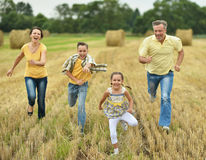 Happy family in wheat field Royalty Free Stock Photography