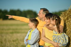Happy family in wheat field Stock Image