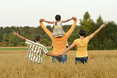 Happy family in wheat field Stock Photography