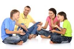 Happy family on a white Stock Photos