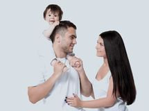 A happy family on white background. Caucasian happy young family with little baby and pretty white smiles - looking at camera stock photography