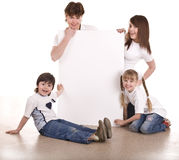Happy family with white banner. Isolated Stock Photos
