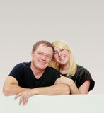 Happy family at the white banner. Stock Photography