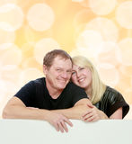 Happy family at the white banner. Stock Images