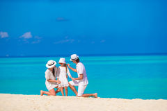 Happy family on white beach Royalty Free Stock Photography