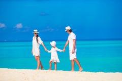 Happy family on white beach Royalty Free Stock Photo
