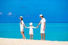 Happy family on white beach Stock Photos