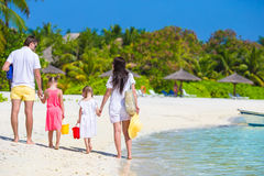 Happy family on white beach during summer vacation Royalty Free Stock Images