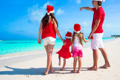 Happy family on white beach during summer vacation Royalty Free Stock Image