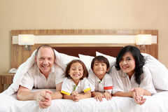 Happy family on white bed Royalty Free Stock Image