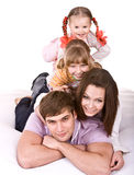Happy family on white bed. stock photo