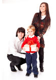 Happy family with white gift box. Stock Photos