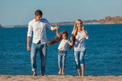 Happy family who playing on the beach. Concept of Royalty Free Stock Photography