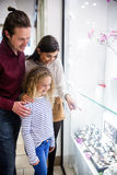 Happy family window shopping in mall Stock Photography