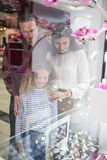 Happy family window shopping in mall Stock Photo