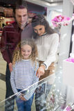 Happy family window shopping in mall Royalty Free Stock Image