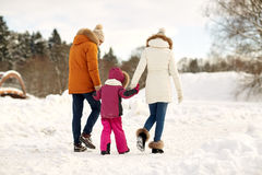Happy family in winter clothes walking outdoors Royalty Free Stock Images