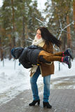 Happy family in winter clothing. laughing Mother and son playing fun game outdoor Royalty Free Stock Photography