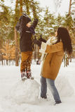 Happy family in winter clothing. laughing Mother and son playing fun game outdoor Royalty Free Stock Photo