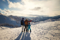 Happy family in winter clothing at the ski resort, winter time Royalty Free Stock Images