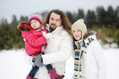 Happy family on a winter day royalty free stock photography