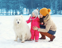 Happy family in winter day, mother and child walking Stock Photo