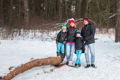 Happy family in the winter forest. Stock Images