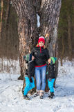 Happy family in the winter forest. Stock Photo