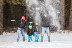 Happy family in the winter forest. Royalty Free Stock Photography