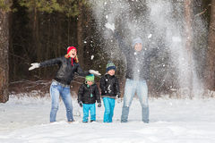 Happy family in the winter forest. Stock Image