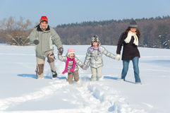 Happy family winter fun outdoors Stock Images
