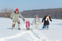 Happy family winter fun outdoors Stock Image