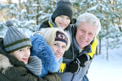 Happy family in winter outdoors Royalty Free Stock Images