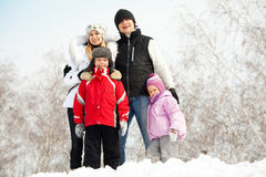 Happy family in winter park. Happy family with children in winter park Royalty Free Stock Images