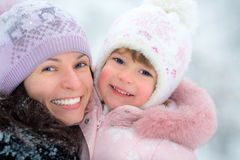 Happy family in winter Stock Images