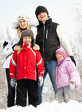 Happy family in winter park Stock Photos