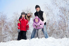 Happy family in winter park Stock Images
