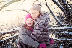Happy Family in Winter Park. Happy Mother with Daughter Royalty Free Stock Photography