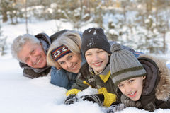 Happy Family in winter park. Portrait of a happy family in winter snowy park Royalty Free Stock Photography