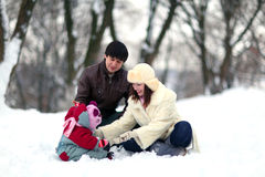 Happy family in  winter park. Happy family in snowy winter park Stock Images