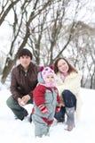Happy family in  winter park. Happy family in snowy winter park Royalty Free Stock Photo