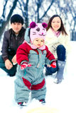 Happy family in  winter park. Happy family in snowy winter park Royalty Free Stock Photos