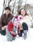 Happy family in  winter park. Happy family in snowy winter park Stock Image