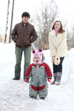 Happy family in  winter park Royalty Free Stock Photo