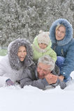 Happy family in winter Royalty Free Stock Photos