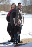 Happy family in winter snow Stock Images