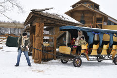 Happy family in winter spend time riding cart Royalty Free Stock Photography