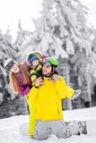 Happy family during the winter vacations. Portrait of a happy family playing with baby boy during the winter vacations on the beautiful mountains with snow stock photo