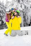 Happy family during the winter vacations. Portrait of a happy family playing with baby boy during the winter vacations on the beautiful mountains with snow stock photos